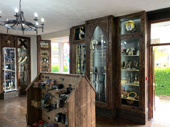Shop area by entrance with medieval displays and products